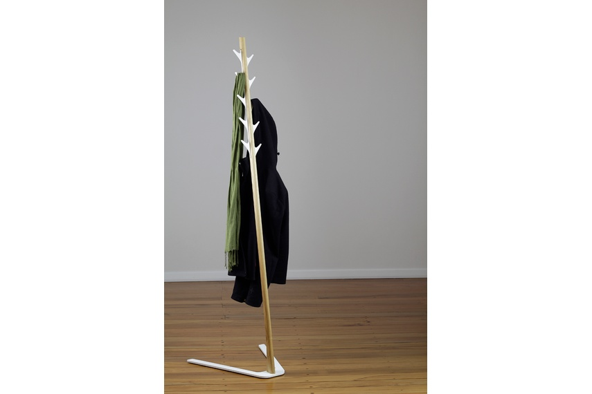 The Frankie coat stand combines handcrafted solid American Ash timber with an aluminium colour accent.
