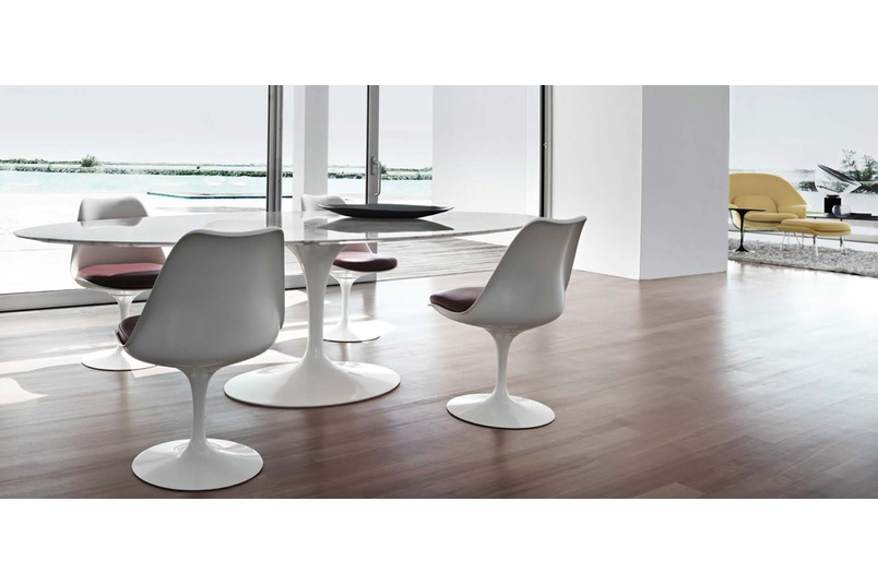 The oval dining table.
