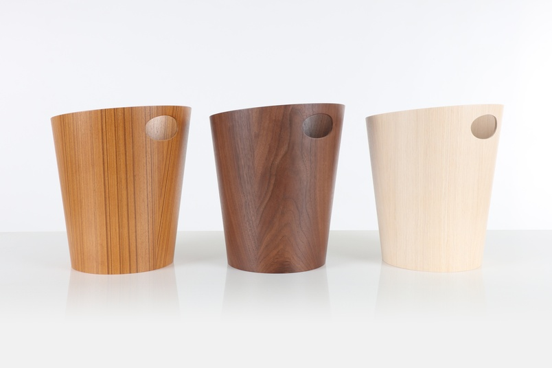 Tapered wastebaskets with handle.