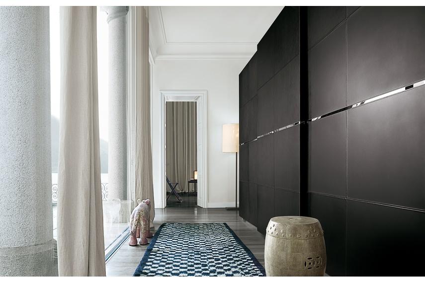 Poliform Bangkok wardrobe with paneled sliding leather doors