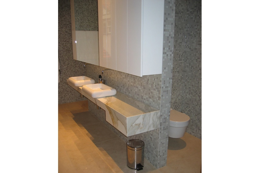Commercial bathroom in NZ tiled with Bisazza'a Nuvole blend