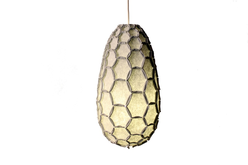 The Nectar lampshade uses the beehive as inspiration to craft lightweight strong shapes from waste material.