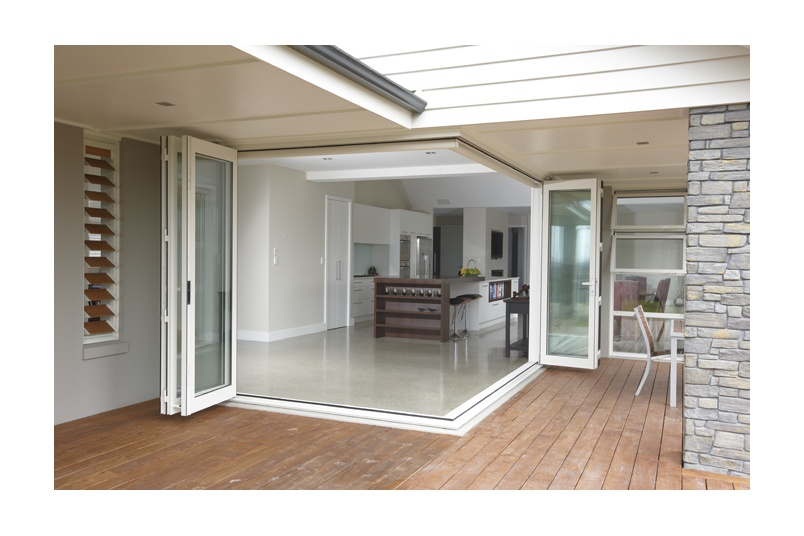 Corner bifolds add a dynamic transition between the indoors and outdoors
